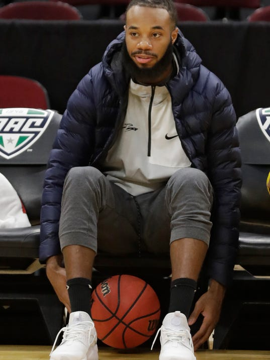 Toledo star guard Tre'Shaun Fletcher watches his team warm up before an NCAA college basketball championship game against Buffalo of the Mid-American Conference tournament, Saturday, March 10, 2018, in Cleveland. Fletcher will miss the Mid-American Conference championship against Buffalo because of an injured left knee. (AP Photo/Tony Dejak)