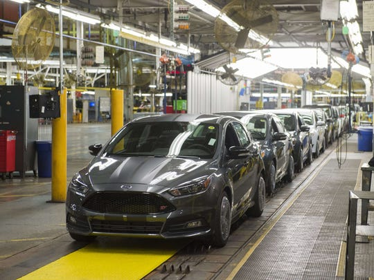 This file photo shows a lineup of Ford Focus vehicles on an assembly line at the Ford Michigan Assembly Plant in Wayne, Michigan in January 2015