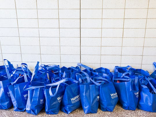 Southside Middle School students stuff bags with donated