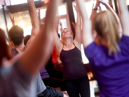 In this file photo, Jackie Dahlheimer leads a Christmas Eve yoga session at House of Yoga in downtown York in 2016.