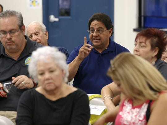 Residents of the neighborhood surrounding the Seville Recreation Center express their concerns to Police Area Representative officers who were at the Corbin/Sambrano Neighborhood Association meeting July 24.
