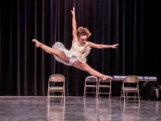 Cescily Kendrick has a high jump during her  dance