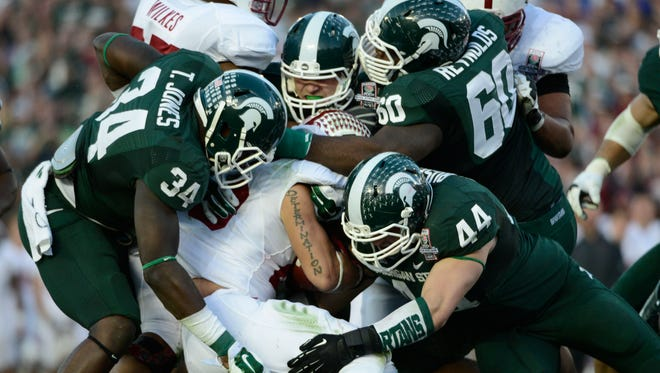 Michigan State's suffocating defense against Oregon's high-powered offense? Yes, please.