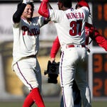Philadelphia Phillies' Freddy Galvis, left, cheers with teammate Odubel Herrera after hitting the winning RBI, allowing Andres Blanco to score, on a pitch by Washington Nationals closer Jonathan Papelbon in the 10th inning Sunday in the Phillies 3-2 win.