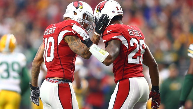 Arizona Cardinals wide receiver Brittan Golden (left) celebrates a play with cornerback Justin Bethel in the first half against the Green Bay Packers at University of Phoenix Stadium.