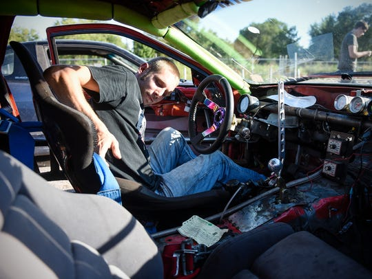 Jerel Saxon gets strapped in to his Mazda RX7 drift