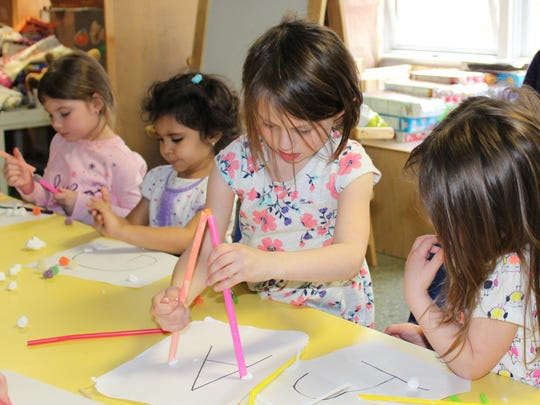 Pre-K and Kindergarten students particiapte in a STEM exercise at St. Catherine of Bologna School in this March 10, 2016 photo. The school had recently earned STEM certification from AdvancED, becoming one of the first three Catholic elementary schools in the U.S. to achieve the designation.