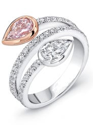 A rare pink pear-shaped diamond is paired with white
