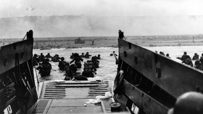 Army troops land on ÒOmahaÓ Beach during the initial landings there on June 6, 1944. They were brought ashore by Coast Guard manned LCVP.