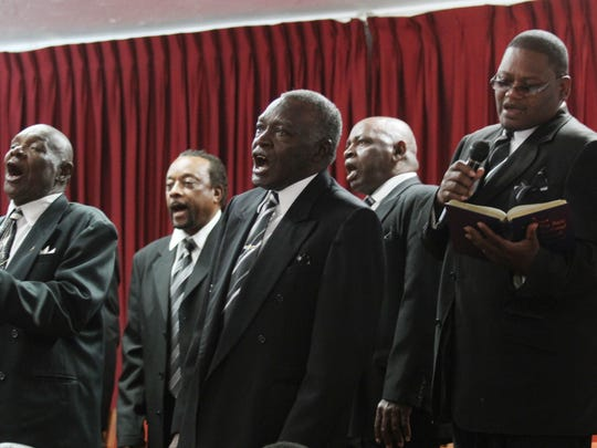 Members of the St. Paul Missionary Baptist Church Male Chorus perform at Mount Olive A.M.E. Church as part of the 100 Men in Black Gospel Male Chorus Concert.