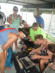 Jamie Cool (from left), Maddy Armstrong, Philip McCleer, Mitchell Lilley, Jamie Krusinski watch as their underwater robot hit its record depth of 189 feet.