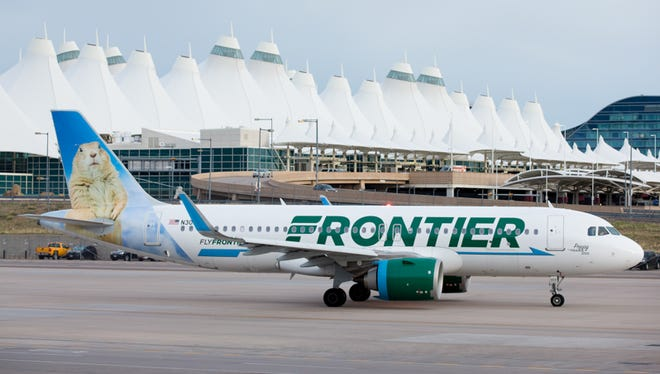 A Frontier Airlines Airbus A320neo taxis out from Denver International Airport in May 2017.