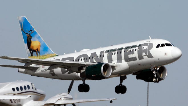 A Frontier Airlines airplane lifts off from a runway at Denver International Airport on Sept. 27, 2007.
