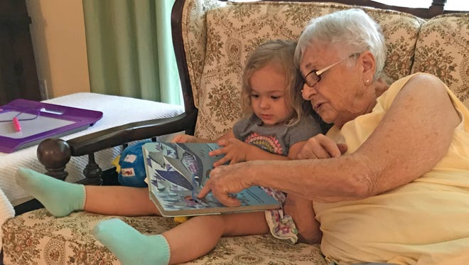 Isabella gets some ready help from her great-grandmother.