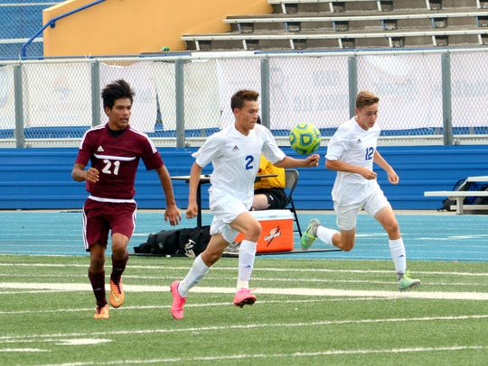 Carlsbad's Jorge Medrano (2) and and Blaine Thompson