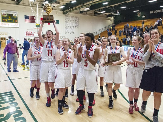 Champlain Valley celebrates its Division I victory over Essex in the high school girls basketball championship game in March. The Redhawks have won 78 games in a row, a Vermont hoops modern record.