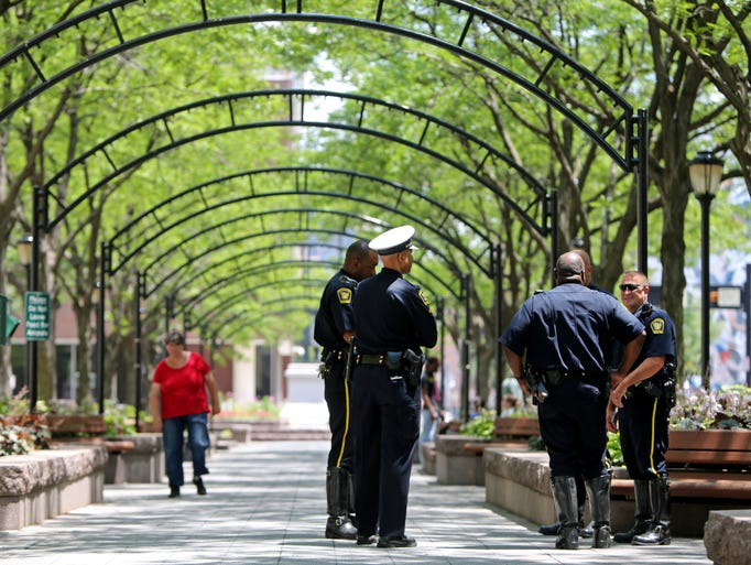 Additional officers will now be on duty at Piatt Park after recent shootings. There will be one officer on patrol from 8 a.m. to 10 p.m. Overnight, there will be regular patrols, according to Sgt. Scott Albert of the Downtown Services Unit. These officers were at the park getting information about the added patrols.