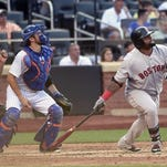 Mets catcher Travis d'Arnaud and Boston Red Sox's Pablo Sandoval watch Sandoval's RBI double off of Mets starting pitcher Jacob deGrom in the sixth inning at Citi Field on Saturday, Aug. 29, 2015, in New York.