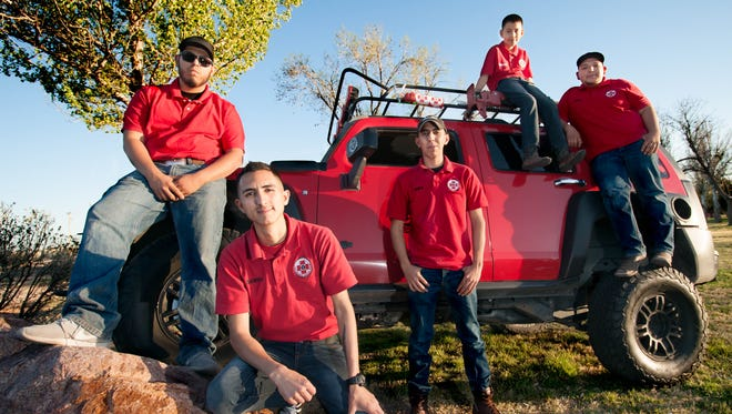 Members of the Las Cruces Reacue Team pose for a photo in front of their rescue vehicle on Thursday. From left to right Israel Vasquez, Daniel El Ashmawi, Chris Barraza, Johan Rodriguez, 9, and Ivan Lozoya.