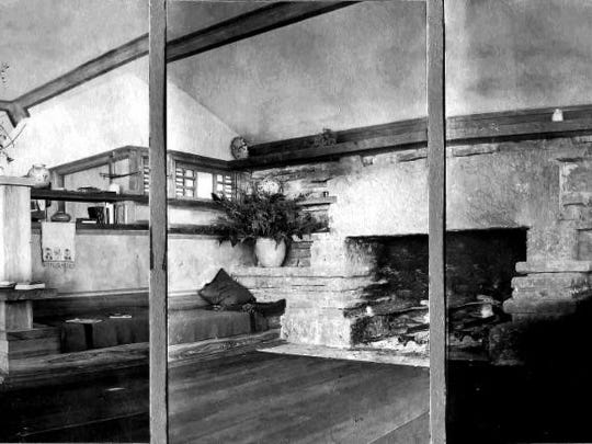 Triptych of living room fireplace at Taliesin. A built-in bookshelf and bench are to the left of the fireplace.  WHS Image ID 29071.