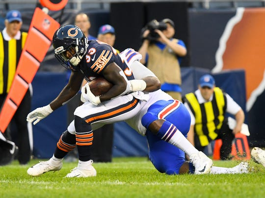 Aug 30, 2018; Chicago, IL, USA;  Buffalo Bills defensive tackle Adolphus Washington (92) makes a tackle on Chicago Bears running back Taquan Mizzell (33) during the first quarter at Soldier Field. Mandatory Credit: Mike DiNovo-USA TODAY Sports