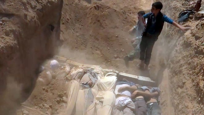 A video purportedly shows bodies of victims of a toxic gas attack in Ghouta and Zamalka on the outskirts of Damascus Aug. 21.