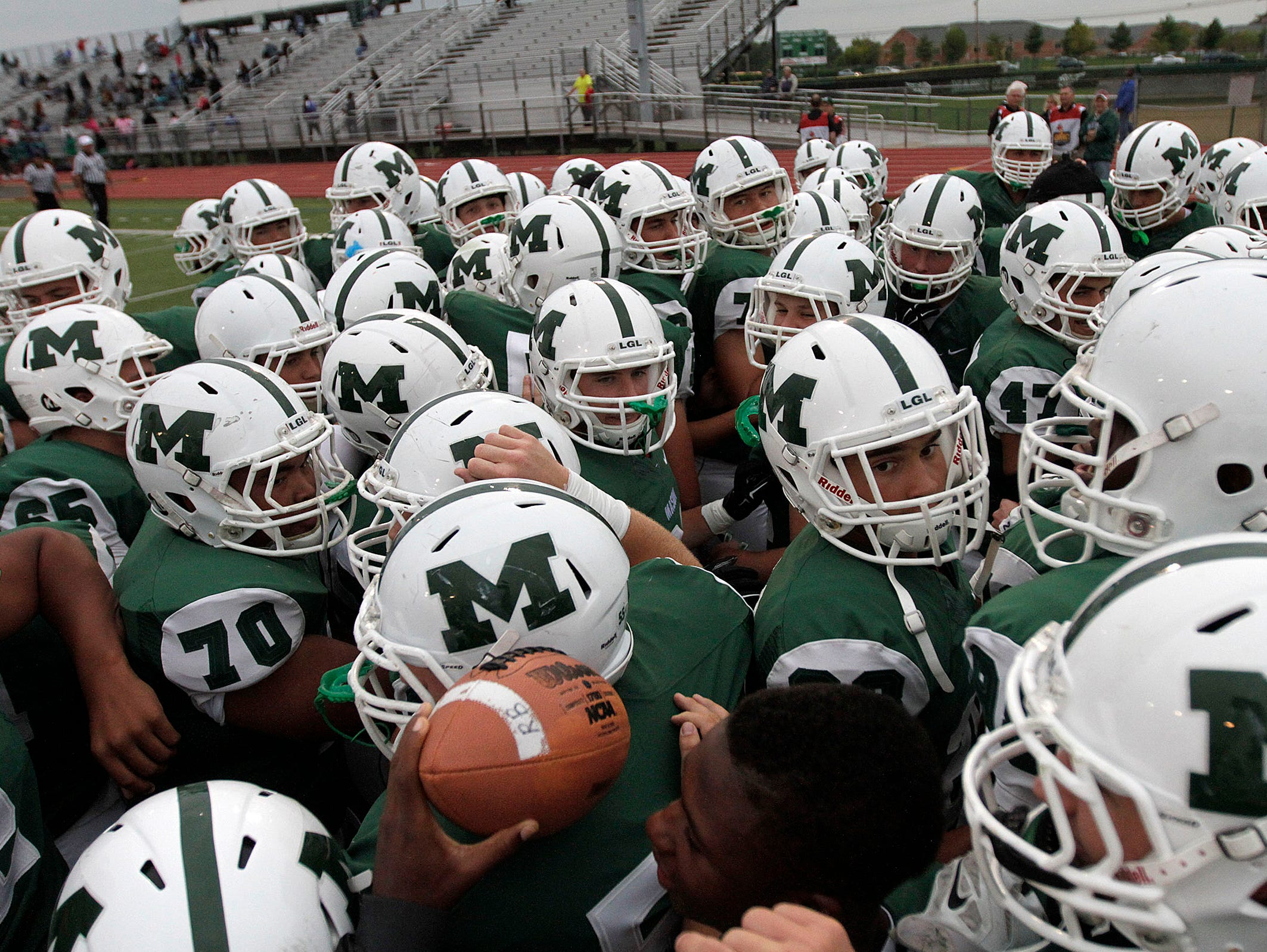 The Mason Comets get pumped up before their game against Winton Woods.