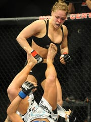 Ronda Rousey (top) and Liz Carmouche fight during their UFC women's world bantamweight championship on  Feb 23, 2013.