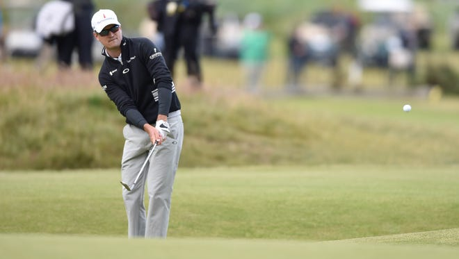 Zach Johnson chips to the 17th green  during the third round of the 144th Open Championship at St. Andrews - Old Course. Mandatory Credit: Steve Flynn-USA TODAY Sports