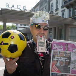 A man jokes outside the hotel Baur au Lac Zurich, where Swiss authorities arrested FIFA officials Wednesday in  Zurich.
