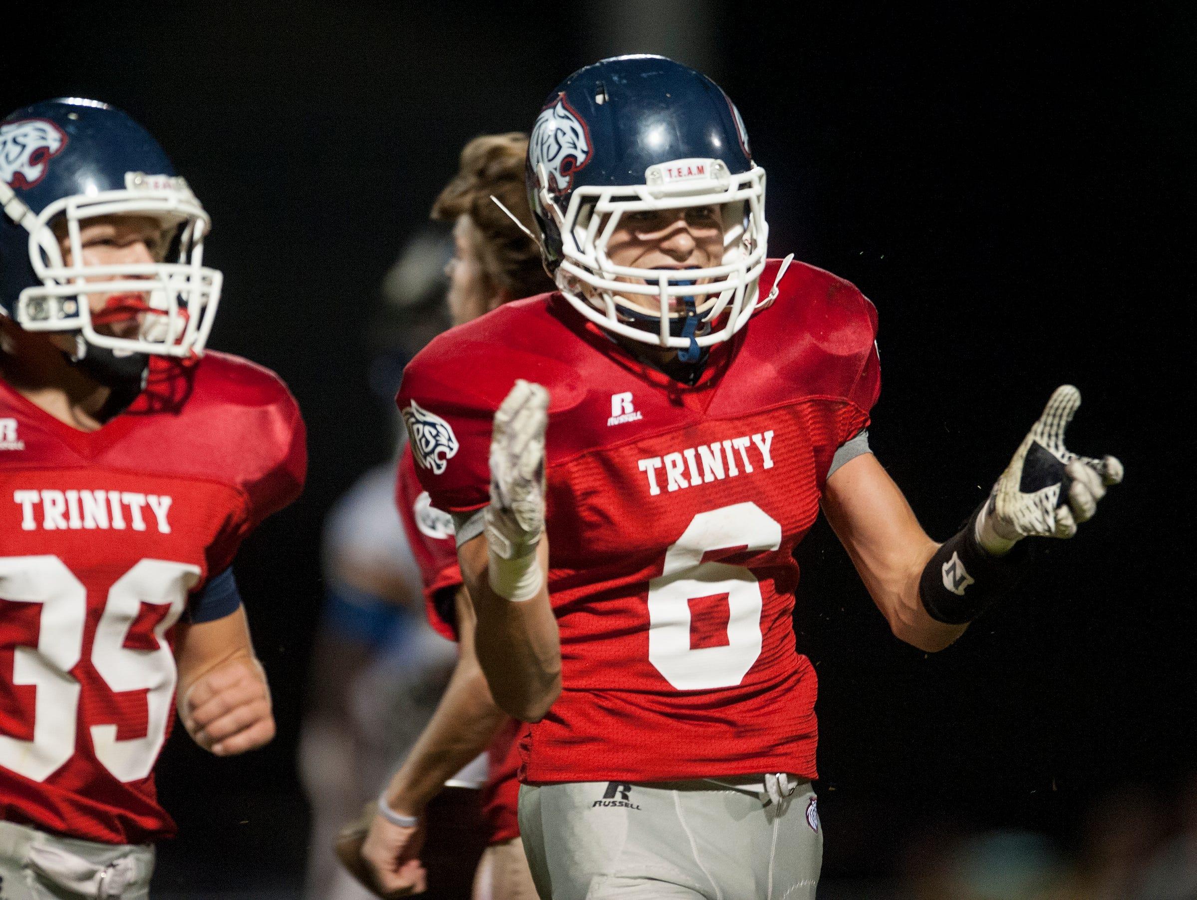 Trinity's Luke Hufham (6) celebrates intercepting a pass against Catholic at the Trinity campus in Montgomery, Ala. on Thursday October 9, 2015.