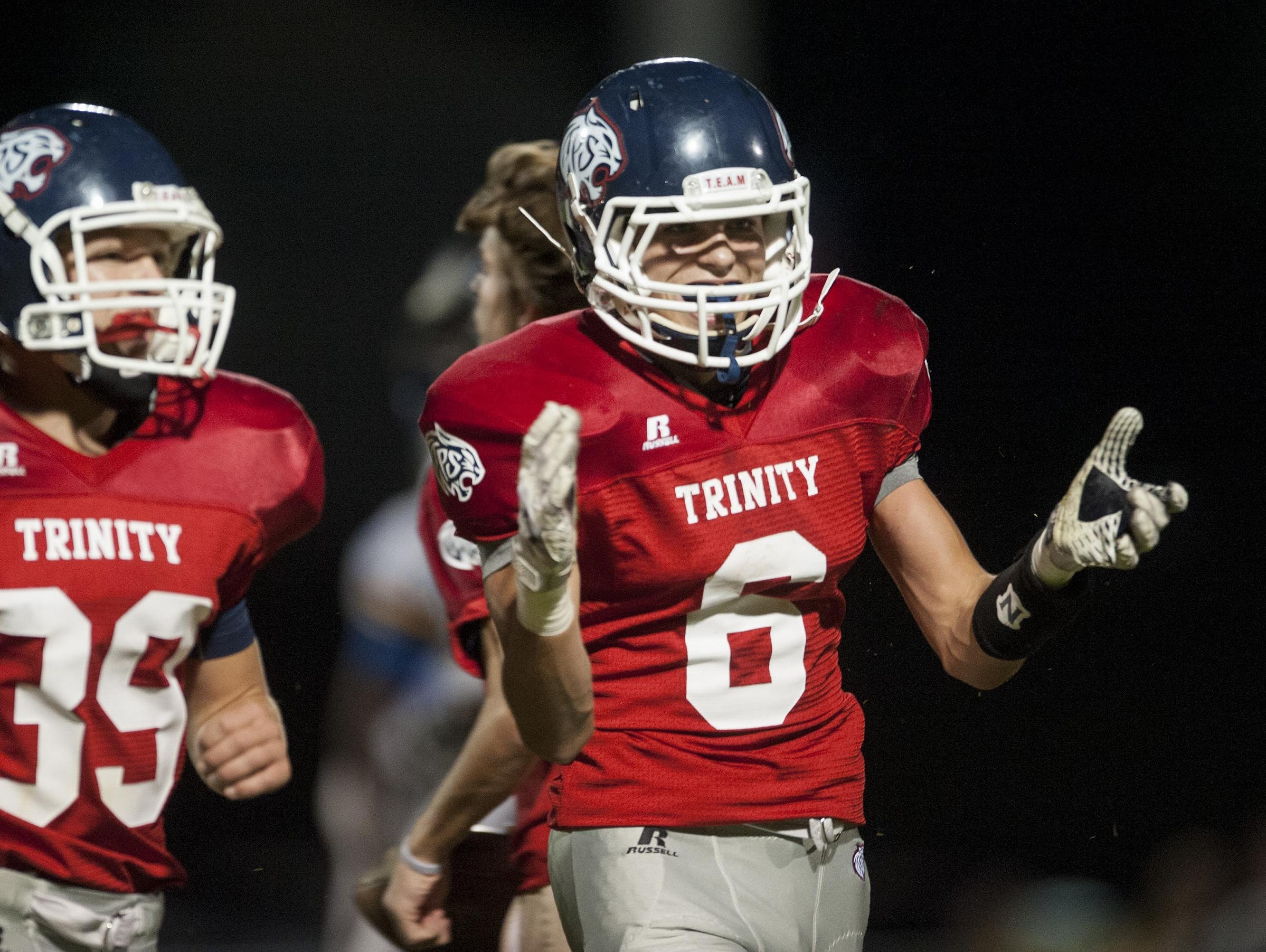 Trinity's Luke Hufham and the Wildcats host Northside in a high school football playoff game on Friday. Trinity's Luke Hufham (6) celebrates intercepting a pass against Catholic at the Trinity campus in Montgomery, Ala. on Thursday October 9, 2015.