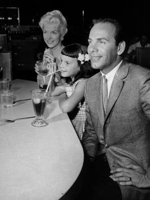 Crooner turned gospel singer Tony Fontane with his wife, Kerry, and daughter, Char, at a soda fountain in California. Fontane performed a series of gospel concerts in Staunton in 1969.