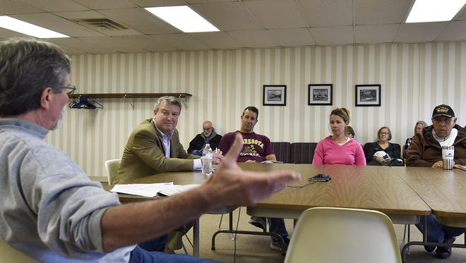 Sturgeon Bay resident Dan Powers, left, asks Rep. Joel Kitchens (R-Sturgeon Bay), second from left,  about state refendums during a listening session at the Door County Library in Sturgeon Bay on Saturday, Oct. 21, 2017.