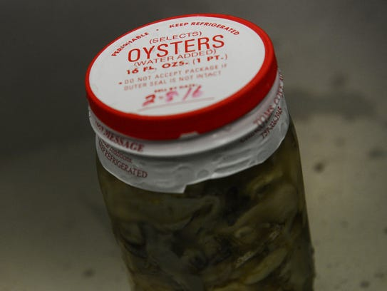 A pint jar of shucked oysters at Tom's Cove Aqua Farms