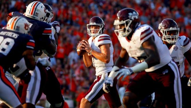 Mississippi State quarterback Nick Fitzgerald (7) drops back to pass against Auburn.