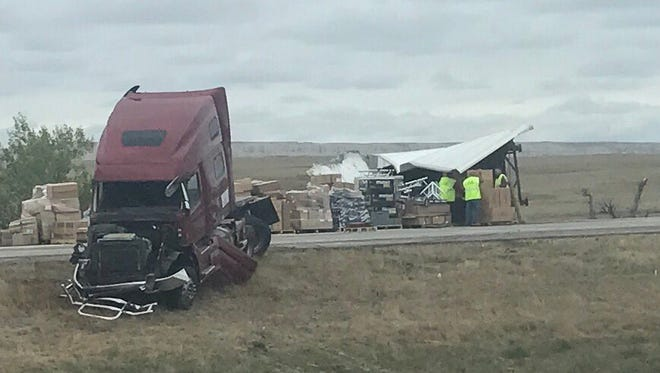 The aftermath of a Monday morning crash between two semi trucks on I-90 near Wall.