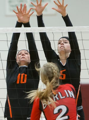 Ripon's Marissa Bunge and Rachel Brewer attempt to block Berlin's Emma Krueger net shot during the September 11, 2014 game.