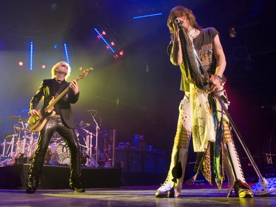 Aerosmith shown performing Glendale Arena.