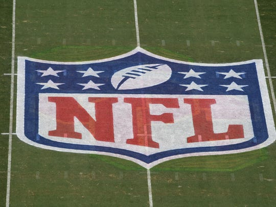 A general overall view of the NFL shield logo at midfield