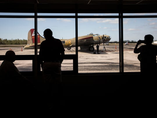 People take pictures of a Boeing B-17G Flying Fortress after a Wings of Freedom Tour flight for veterans on a Consolidated B-24 Liberator in Naples on Thursday, Feb. 1, 2018.