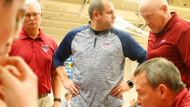 The Seaman Board of Education will vote on terminating the contract of Seaman High School assistant basketball coach Jeffrey Pierce, middle, at noon Friday. Pierce has been charged with two counts of producing child pornography and one count of possession of child pornography.