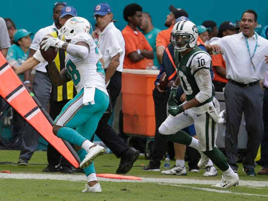 Miami Dolphins cornerback Bobby McCain (28) intercepts a pass intended for New York Jets wide receiver Jermaine Kearse (10), during the second half of an NFL football game, Sunday, Oct. 22, 2017, in Miami Gardens, Fla. The Dolphins defeated the Jets 31-28. (AP Photo/Lynne Sladky)