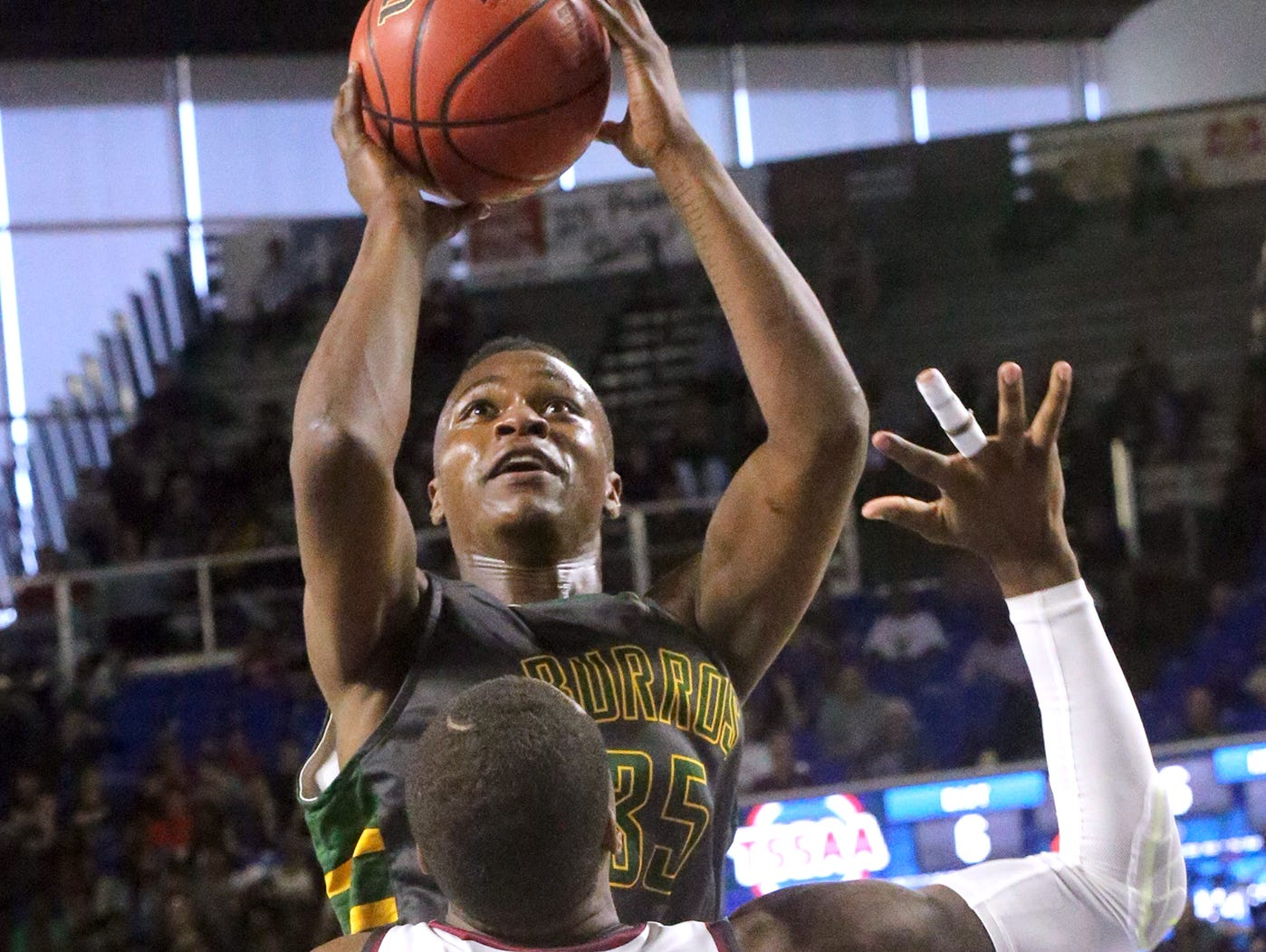 Hillsboro's Thomas Smith (35) goes up for a shot as Memphis East's Teddrick McGhee (5) guards him during the State Tournament Quarterfinal game Wednesday at MTSU.