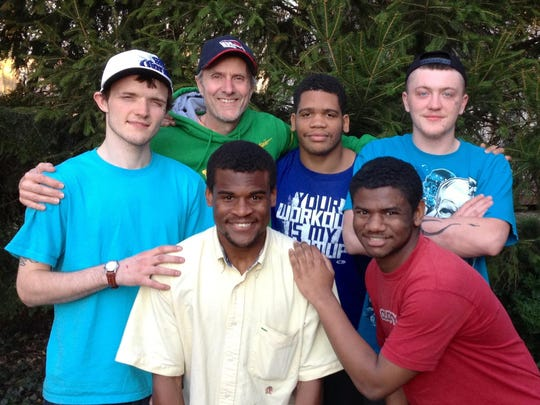Andrew Peterson, center, with his father and brothers.
