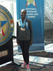 Linda Bowers poses with her medals from the National Veterans Golden Age Games held this August in Omaha, Nebraska.