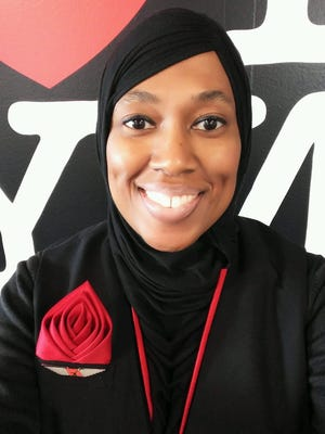 Charee Stanley, a Muslim flight attendant, says ExpressJet suspended her for refusing to serve alcohol, which is against her religious beliefs.