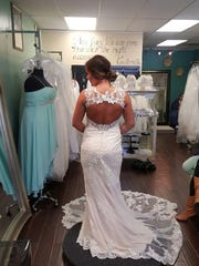 Melaine Smith tries on her wedding dress at Rina's