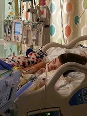 Daisy Hader rests in her hospital bed at Seattle Children's