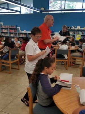 Exalted Ruler Paul Diaz and Pat Diaz provide dictionaries for students at Dodgertown Elementary School.